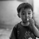 Boy Eating Snacks @ Laos