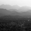 Cityscape And Mountains In Luang Prabang