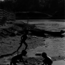 Silhouettes Of Three Kids Playing On The Dry Riverbed @ Laos