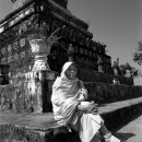 Monk Sitting Beside A Pagoda @ Laos