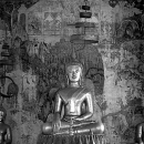 Buddha Image In The Dark Hall Of Wat Pa Huak
