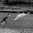Boy Throwing A Net In Nam Khan River @ Laos