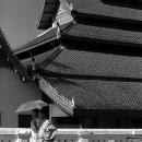 Wat Mai And Monks Putting An Umbrella Up