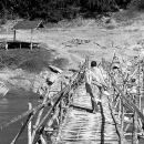 Monk Crossing The Bamboo Bridge @ Laos