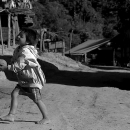 Shoeless Boy Playing With A Ball @ Laos