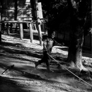 Boy Runs With A Long Pole In The Shade @ Laos