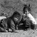Two Girls Sitting On The Dirt Road @ Laos