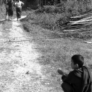 Boy Sitting At The Entrance Of A Path @ Laos