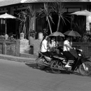 Motorbikes Running With Umbrellas @ Laos