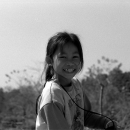 Bashful Smile Of A Girl Riding A Bike @ Laos