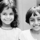 Two Smiling Girls With Big Eyes