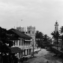 Two Figures Walking The Street Of Galle