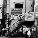 Woman Descends The Stairs Beside Signboards @ Sri Lanka