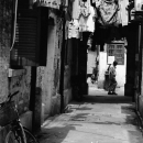 Man Walking Across The Alleyway @ China