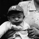 Cool Baby Wearing A Striped Cap @ China