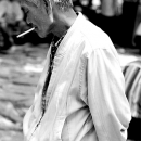 Gray Haired Man With A Cigarette