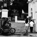 Tricycle And Youngsters At The Entrance