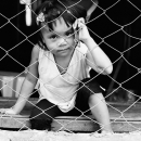 Girl Stares At The Other Side Of The Wire Netting @ Philippines