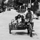 Family On A Bicycle With A Side Car