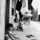 Two Kids Playing In Front Of A House @ Philippines