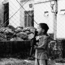 Boy Holding The Gun In His Mouth