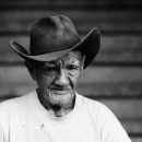 Wrinkle-faced Man With A Cowboy Hat