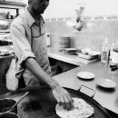 Man Toasting Chapati