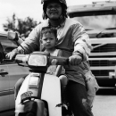 Father And His Son On A Honda Motorbike