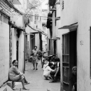 Locals Relaxing An Alleyway