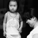 Girl Standing Beside Her Mother @ Vietnam
