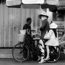 Mother And Her Daughter On A Bicycle