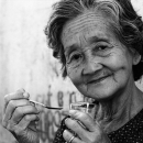 Older Woman Holding A Spoon @ Vietnam