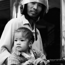Father Wearing A Helmet And His Little Daugther @ Vietnam