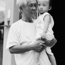 Smiling Man And His Nonchalant Grandson @ Vietnam