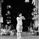 Girl In Front Of A Household Goods Store