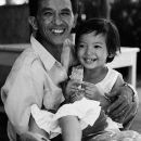 Smiling Father Holding Smiling Daughter