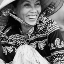 Woman With A Conical Hat Laughs