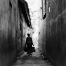 Old Woman In The Alleyway