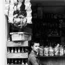 Man Beside Bottles Of Cola @ Nepal