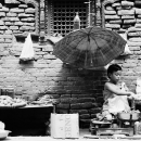 Girl Working Under The Unbrella