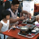 Father And His Daughter In The Night Market
