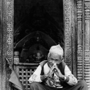 Man In Front Of A Small Shrine @ Nepal