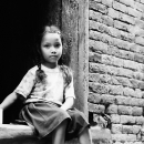 Girl Tying Her Hair In Braids @ Nepal