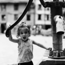Little Girl By A Well