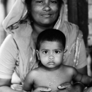 Mother With A Soft Face Holds Her Son @ Bangladesh