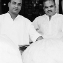 Two Men Wearing White Clothes
