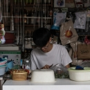 Young Man Making Betel Nuts