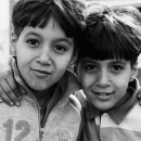 Brothers With Their Arms Around Each Other