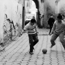 Boys Playing Football In The Alleyway