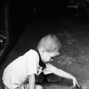 Boy Playing Alone